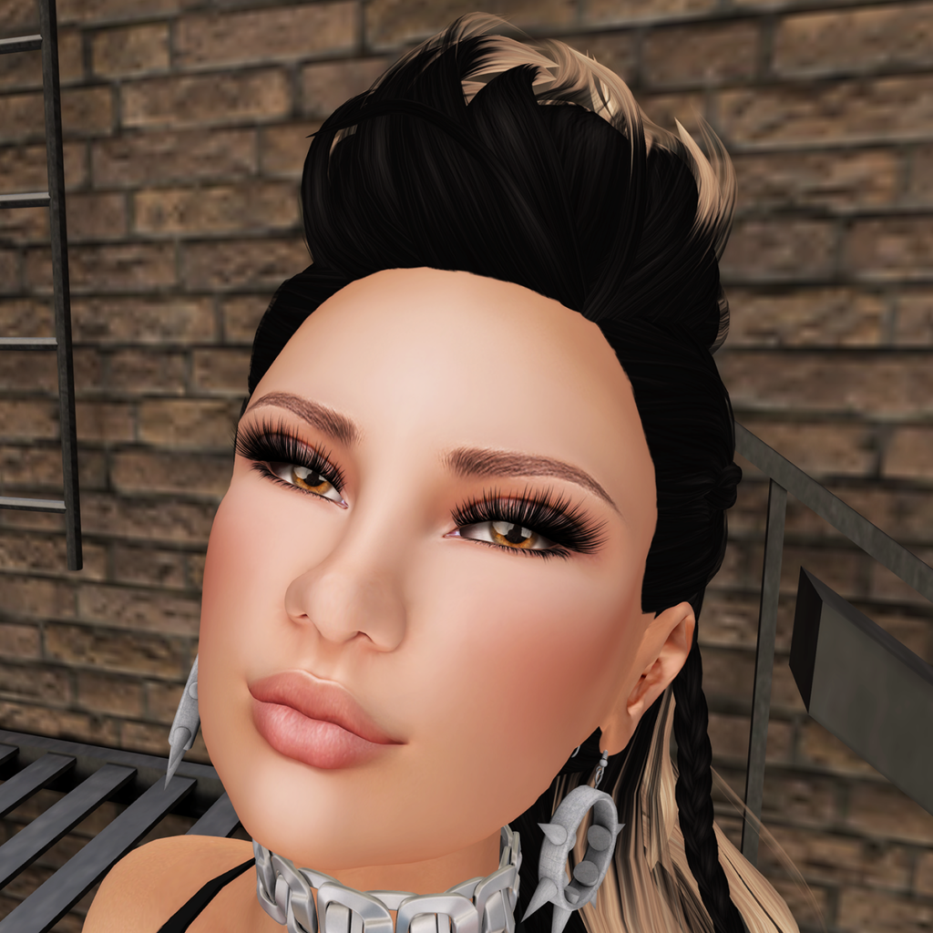 A female Second Life avatar smiles at the camera.
