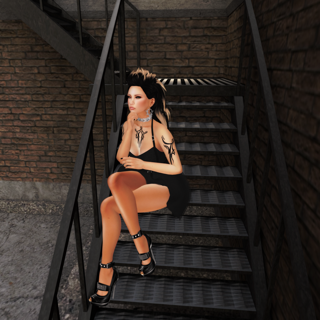 A female Second Life avatar with tattoos sits on the stairs.