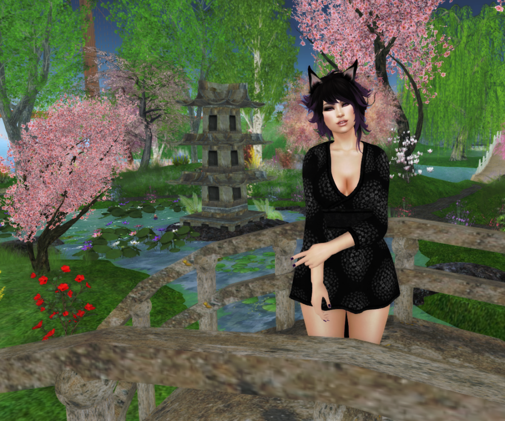 A female second life avatar with a fox tail and ears. She has purple hair.