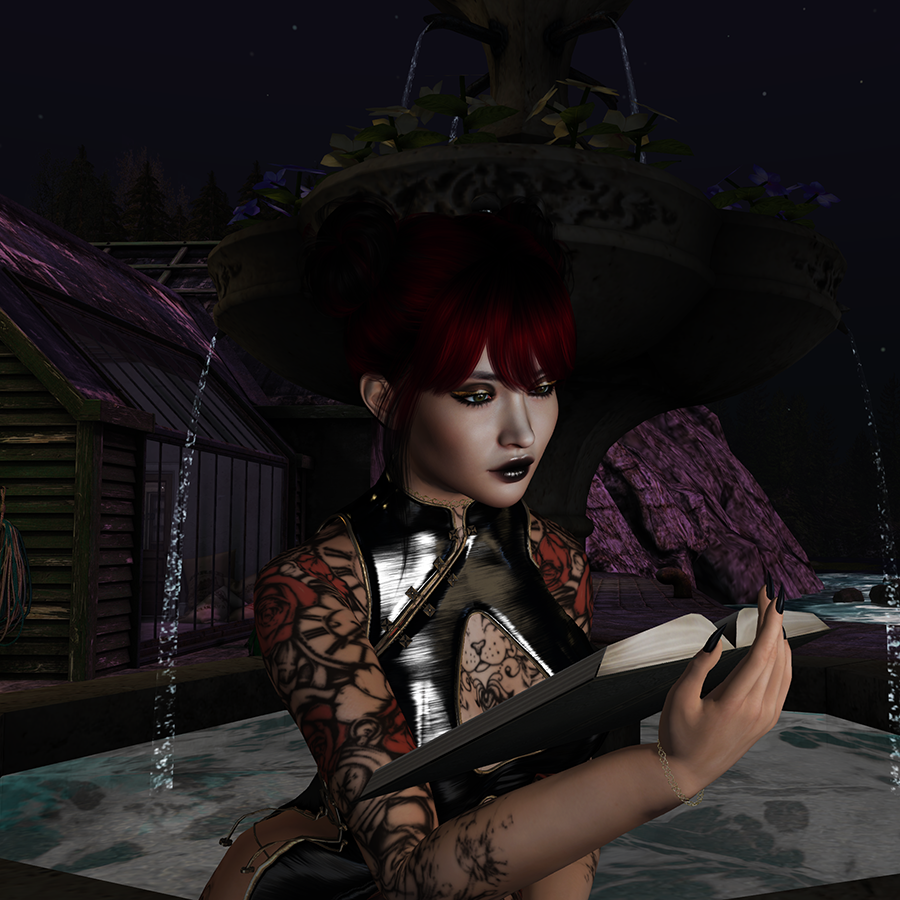 A Second Life avatar with red hair and a black dress sits on a fountain and reads a book.