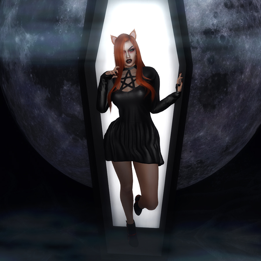 A second life avatar with fox ears and a black pentagram dress emerged from a coffin in the moonlight.